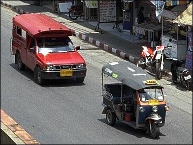 Tuk tuk (front) and a songtaew.