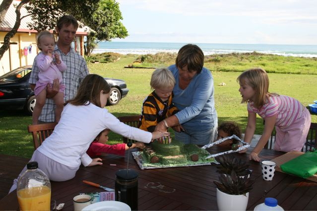 Mum with her lawn mower birthday cake. See how close to the beach we were!