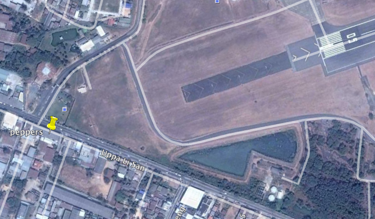 A google earth image showing how close Peppers is to the runway