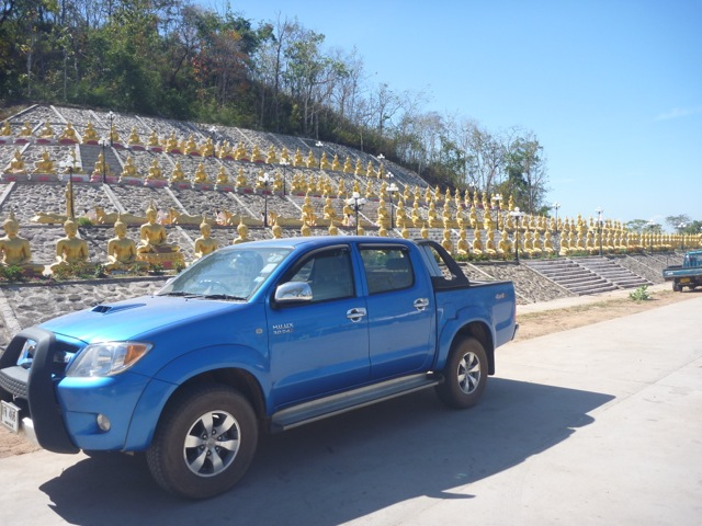 This is my car in front of hundreds of smaller Buddha statues.