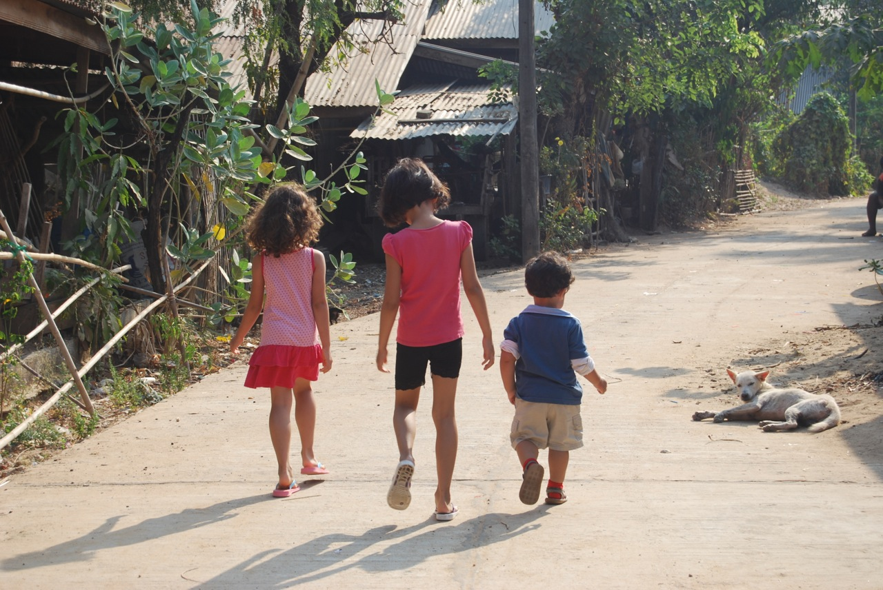 Marisah, Ariya and Jacob walking down the road in the village to go and visit their Auntie.