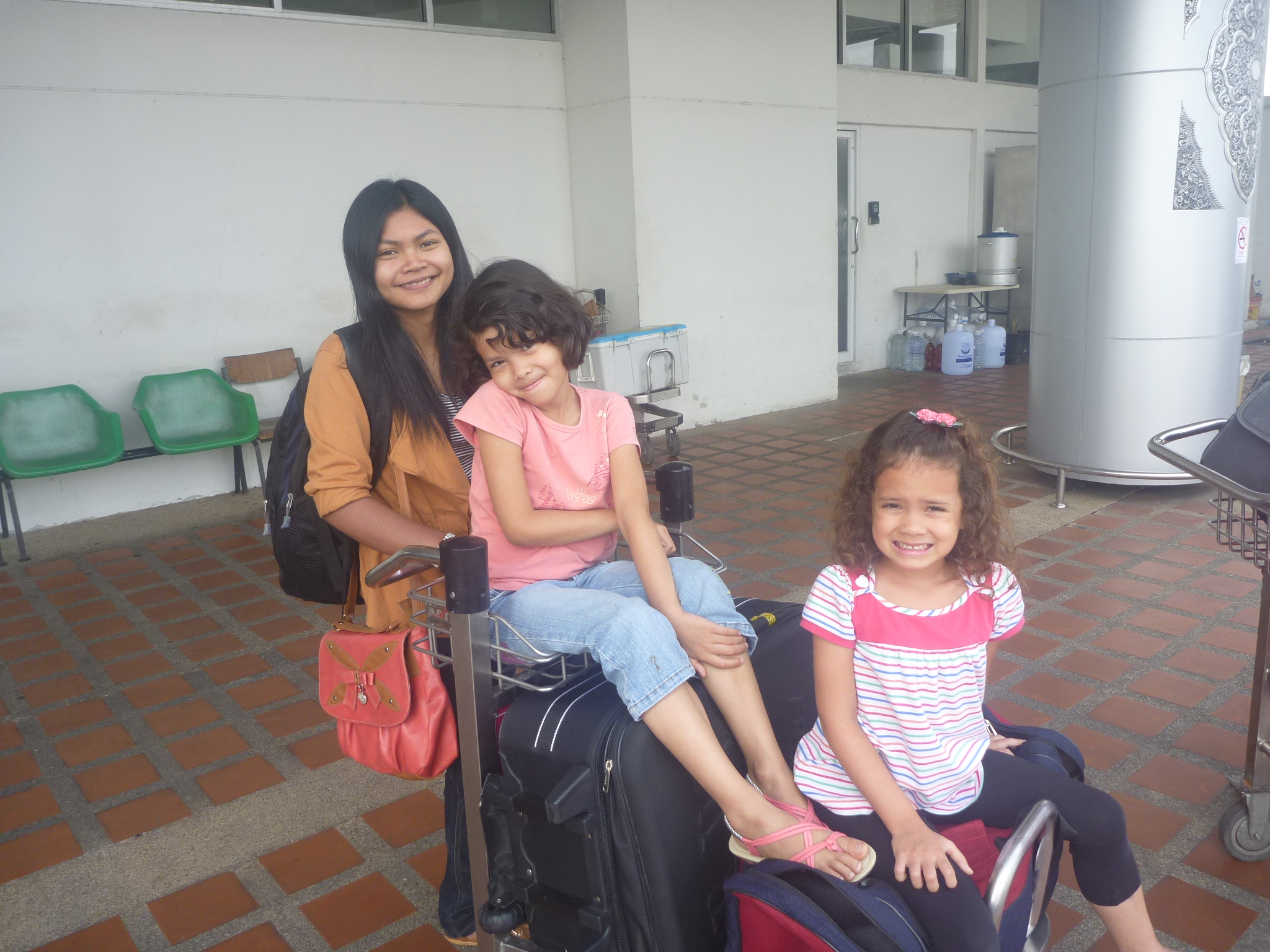 My niece Bow and my girls waiting for the hotel transfer van at Chiang Mai airport.