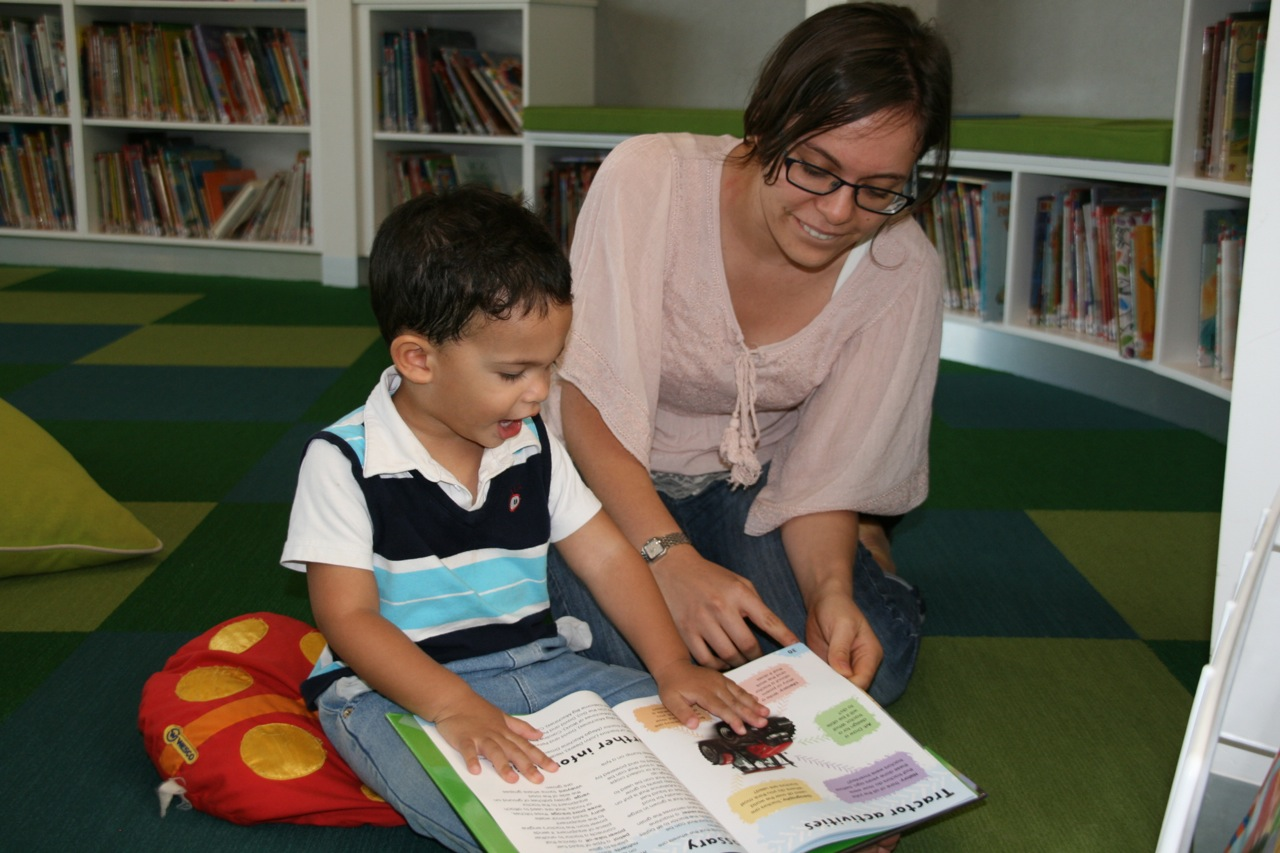 Kununurra has a brand new Library so we started some regular trips to relax, read and borrow some books. On this day we ran into Jessica and she spent a little time listening to Jacob 'read' his book about Tractors to her. Look at the excitement on his face!
