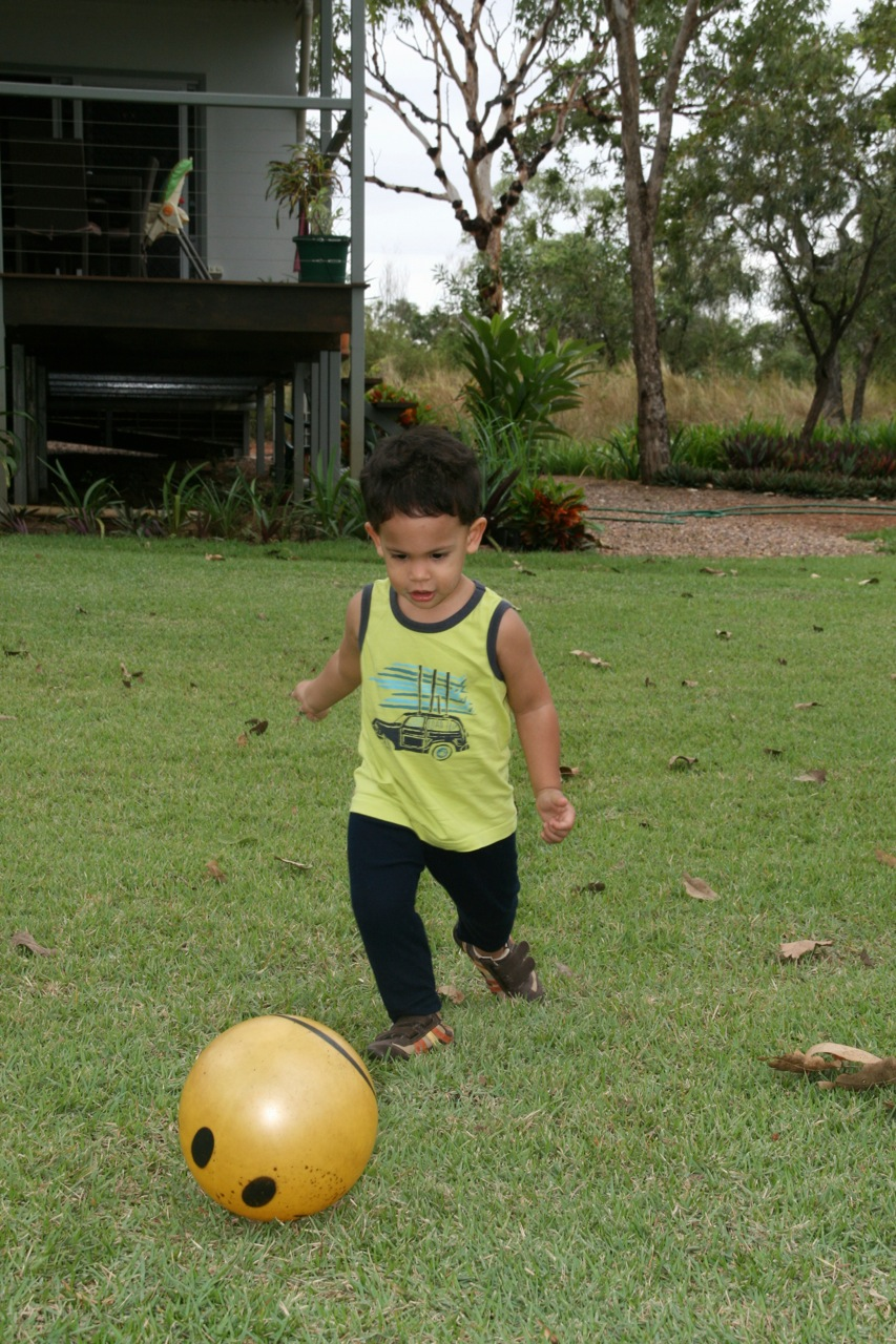 His dirt drawing stick or hose would quickly be thrown away however if Daddy came outside with a ball to kick. He loves kicking and throwing any ball he can get his hands on and I was surprised to find out very quickly that his left foot was much preferred over his right.
