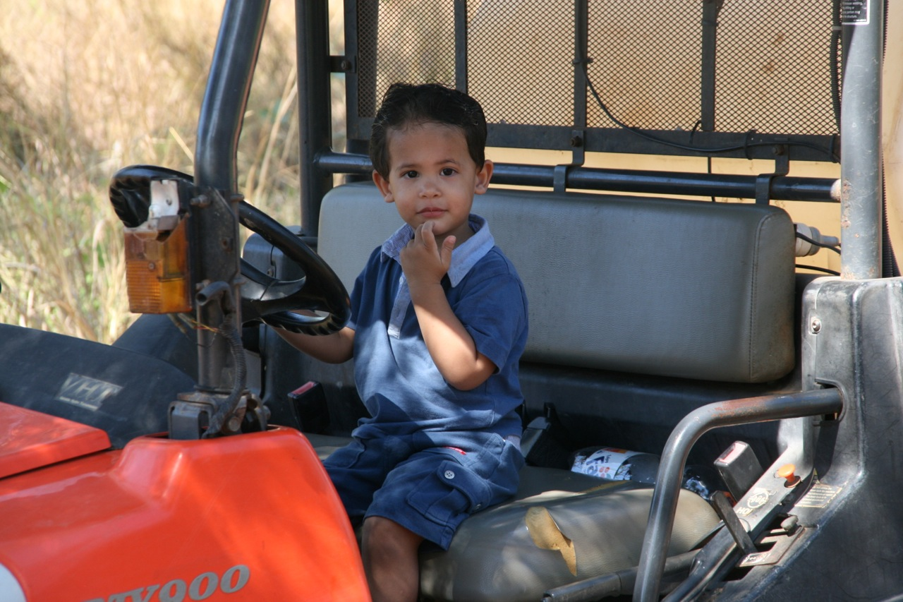 Jacob playing on the Kubota ATV