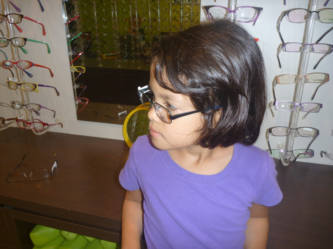 Ariya trying on some glasses. Thankfully she did not end up needing them which unfortunately I could not say the same for myself.