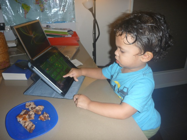 He is actually pretty good at handling the iPad. Here he is playing traffic rush which he is actually pretty good at.