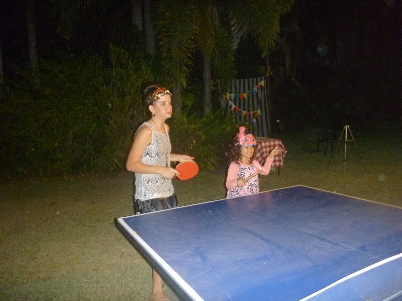 Here is the birthday girl playing Ping Pong with Marisah. My girls love Ping Pong and just recently I bought them a table for our verandah.
