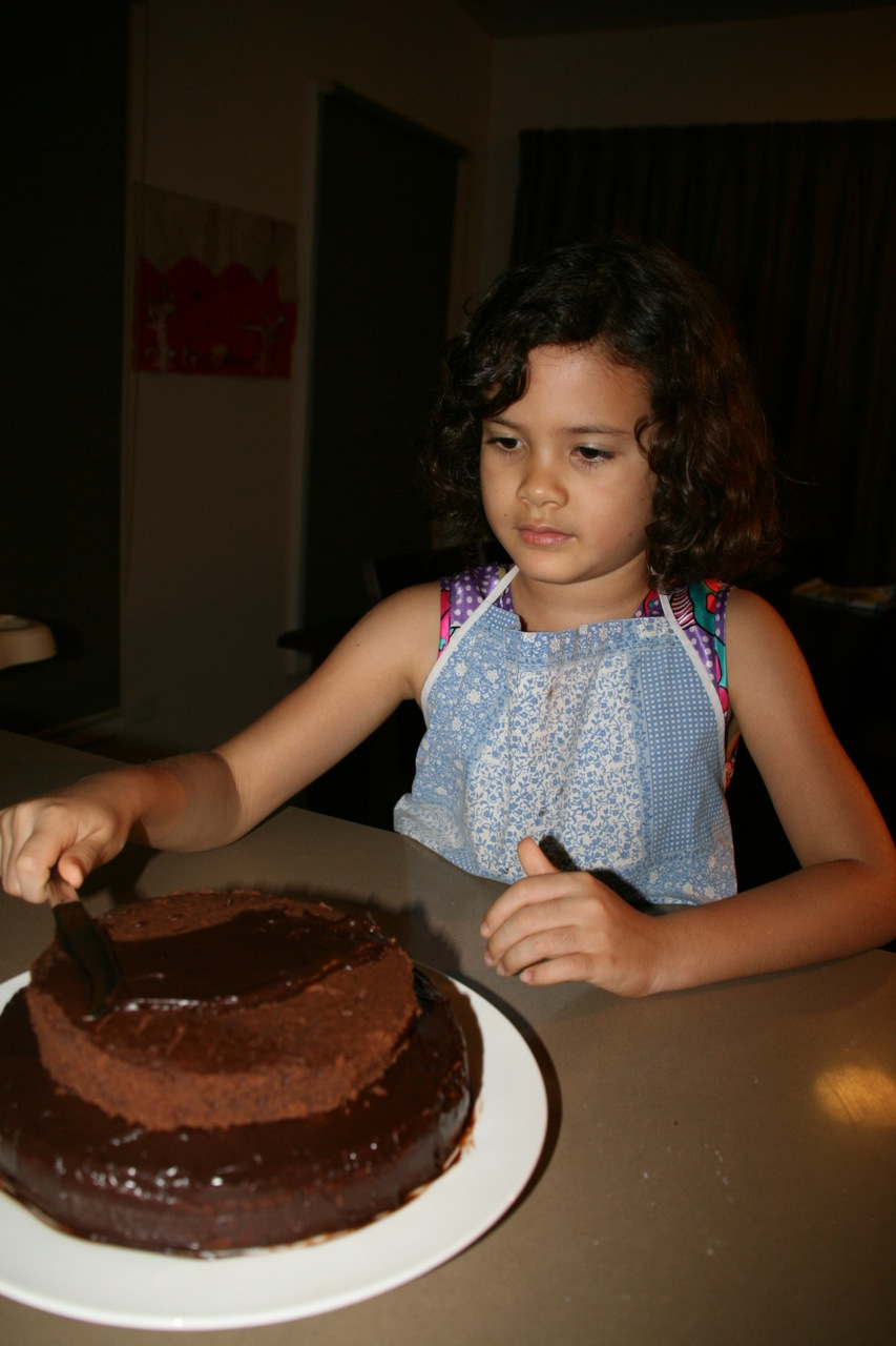 The night before Marisah got to stay up late to help Mum decorate the birthday cake. I love the complete concentration.