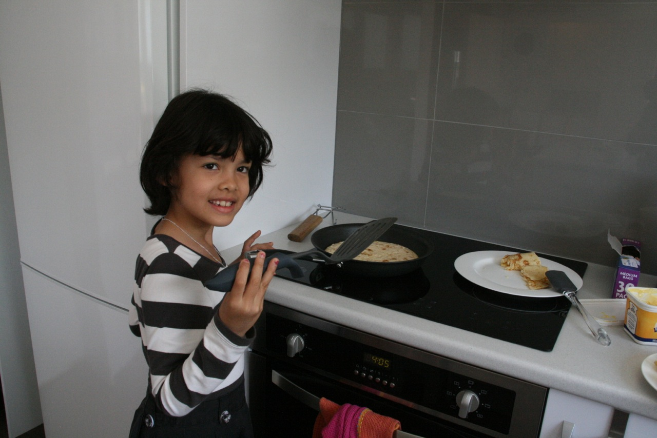 Kid cooking pancakes