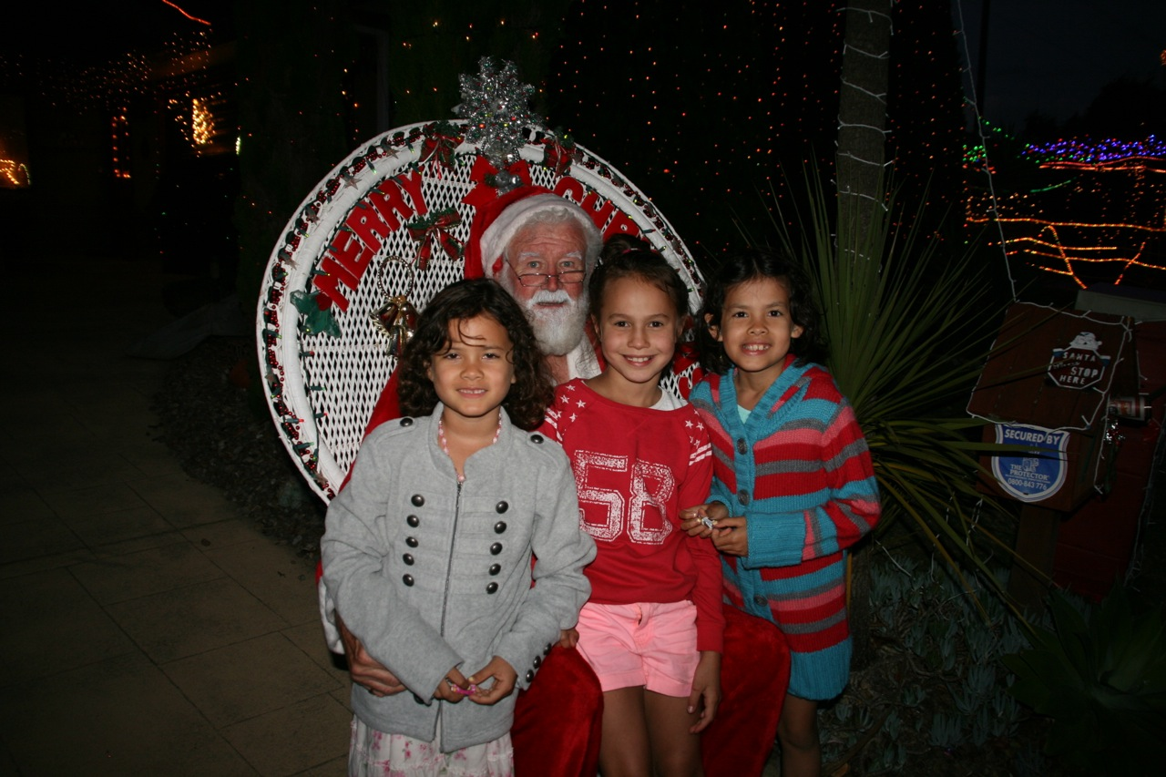 Whenever we are in Tauranga for Christmas we always head to Plover Place. It is a tiny little street in Maungatapu that has the most amazing Christmas lights. This year it had a live band and as always a resident santa. The girls are pictured here with their friend Elise.
