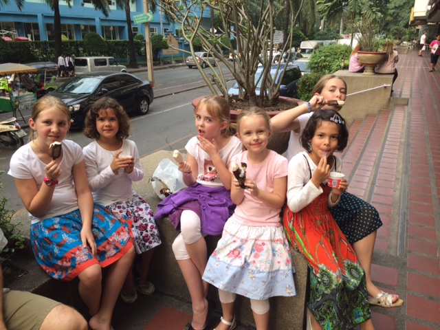 The kids on their first afternoon together eating ice cream on the streets of Bangkok.