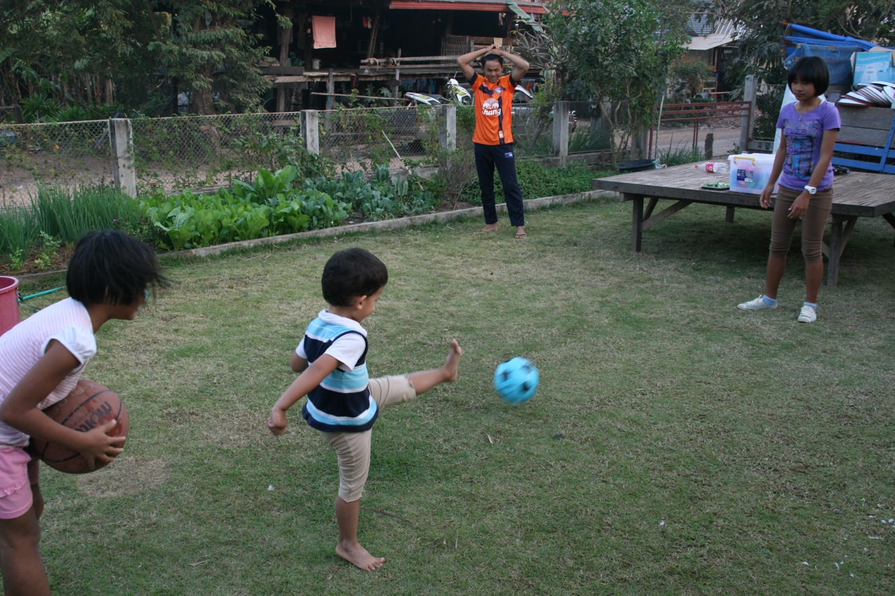 Kicking the ball with his older cousins is always a great way to spend an afternoon. Well for him anyway!