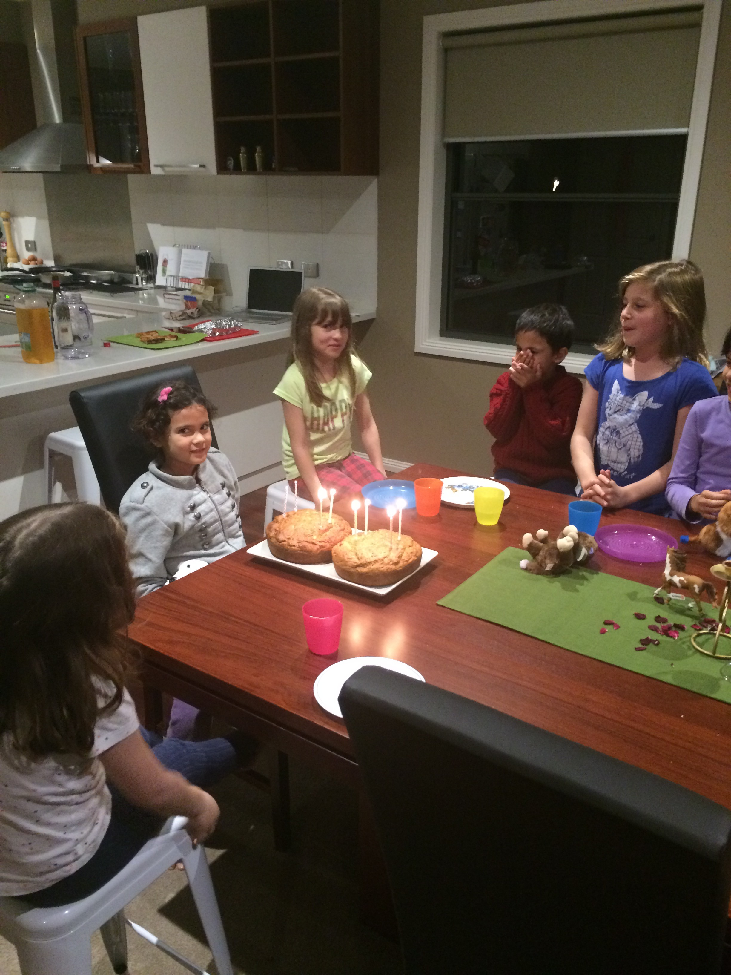 Mustering enough energy to blow out the candles.