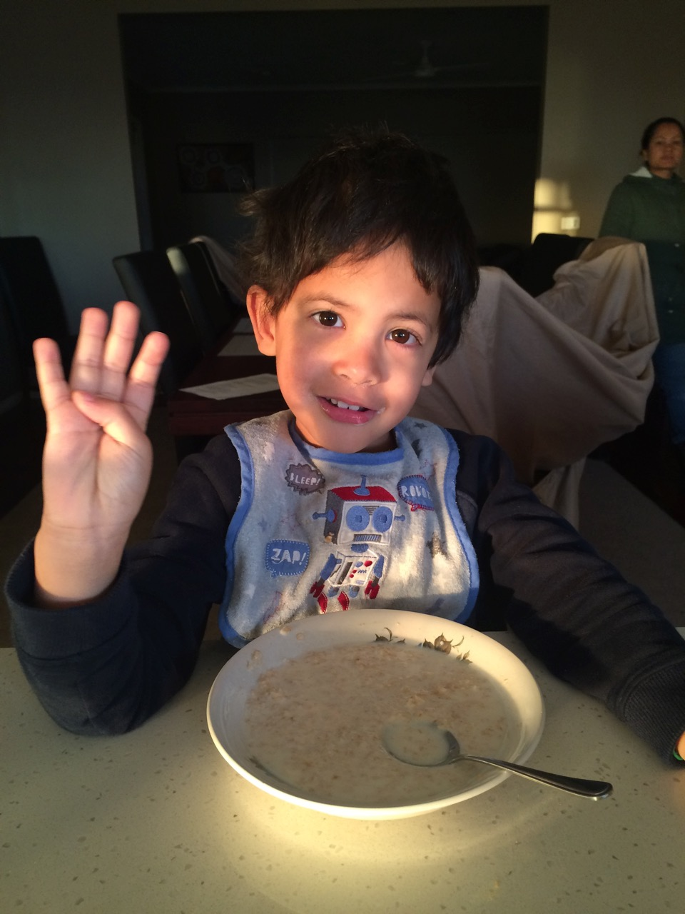 Still waking up with a bowl of porridge showing me with his fingers how old he now is.