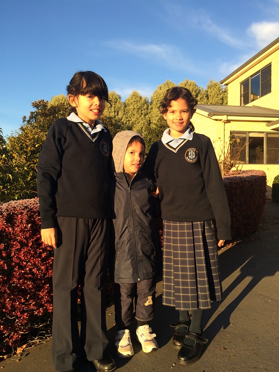 All three off to school on a cool winters morning.